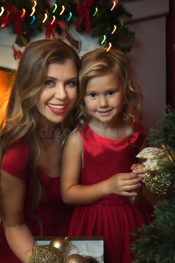 little girl with her mama in christmas environment royalty free stock photography