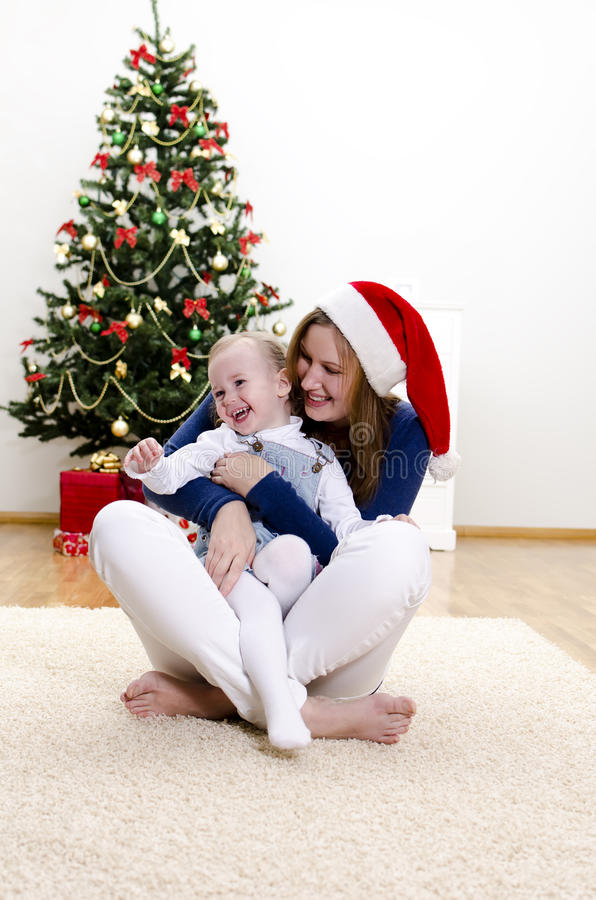Download Little Girl And Her Mom Having Fun At Christmas Stock Image - Image: 22119163