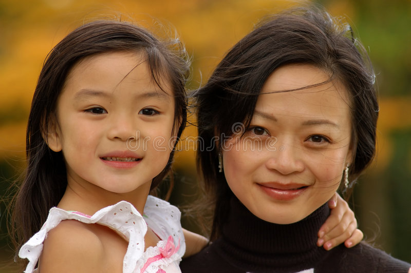 Little girl and her mother stock photos