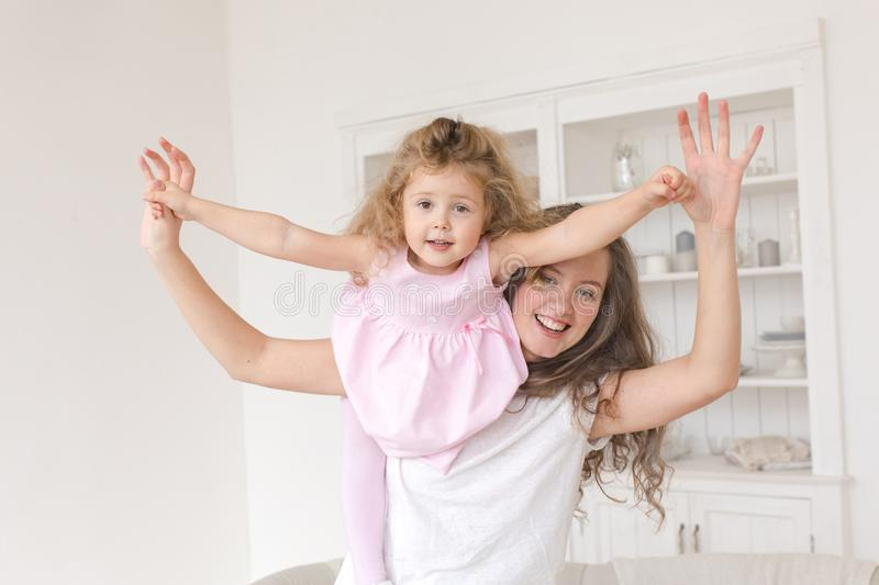 Little girl with mother playing in flight airplane stock image