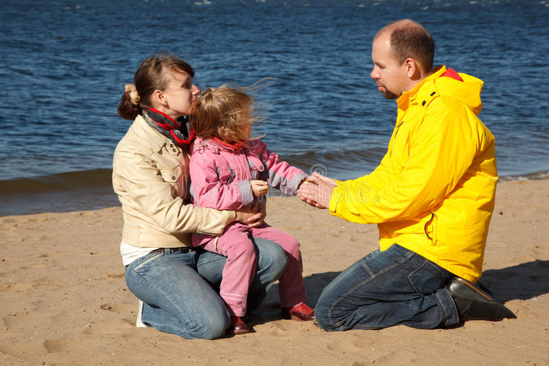 Download Little Girl With Her Parents At Beach Stock Image - Image: 13022085