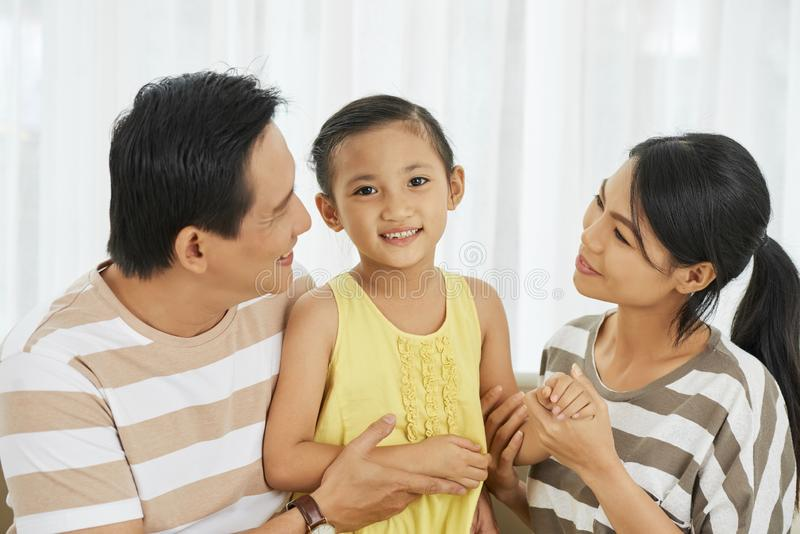 Little girl with her parents stock photos