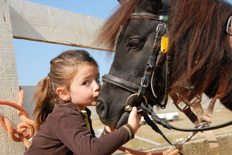 Little girl and her pony stock image