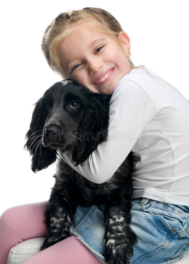 Little girl with her puppy. Over white royalty free stock photo