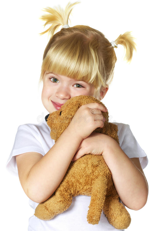 Little girl with her puppy toy. Over white stock photo