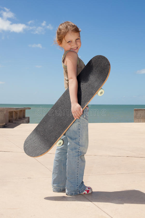 Child with skateboard royalty free stock images