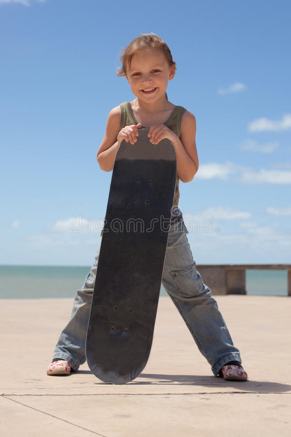 Child with skateboard royalty free stock photo