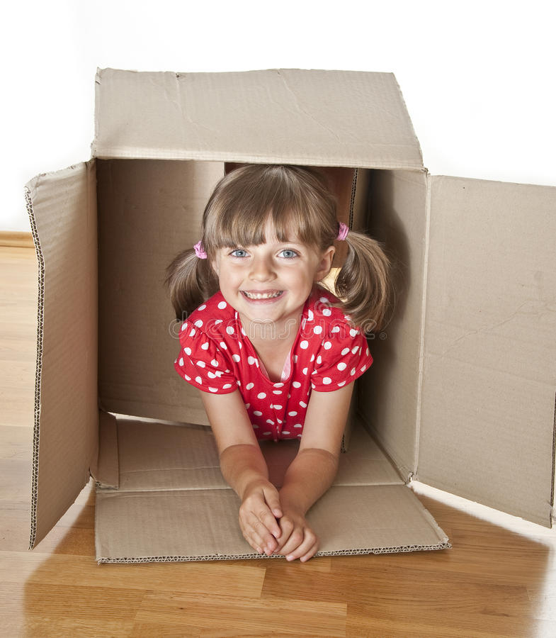 Download Little Girl Hiden Inside A Paper Box Stock Photography - Image: 25670402