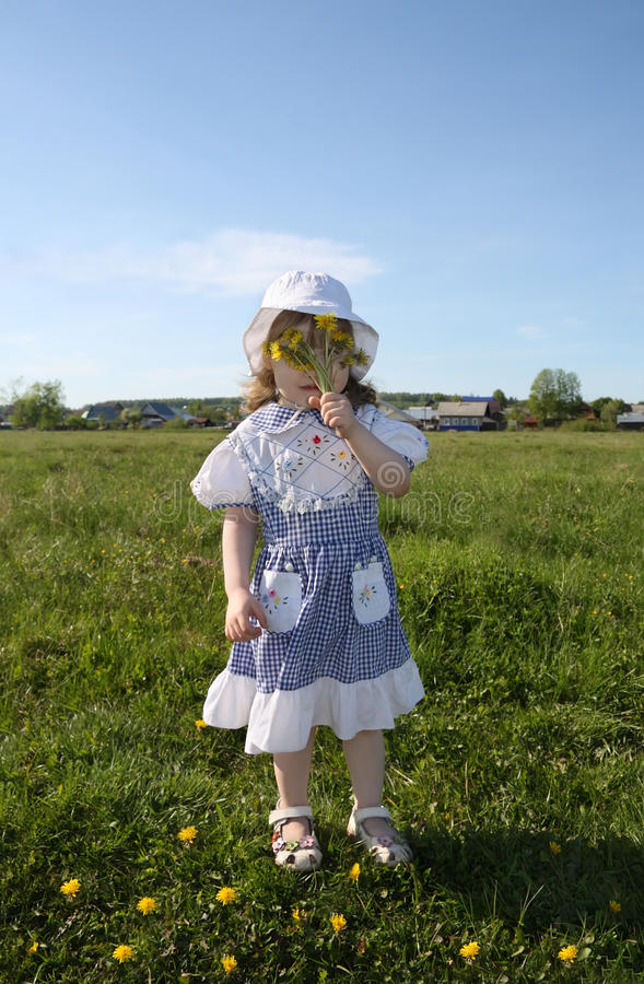Download Little Girl Hides Her Face In Yellow Dandelions Stock Photo - Image: 25350792
