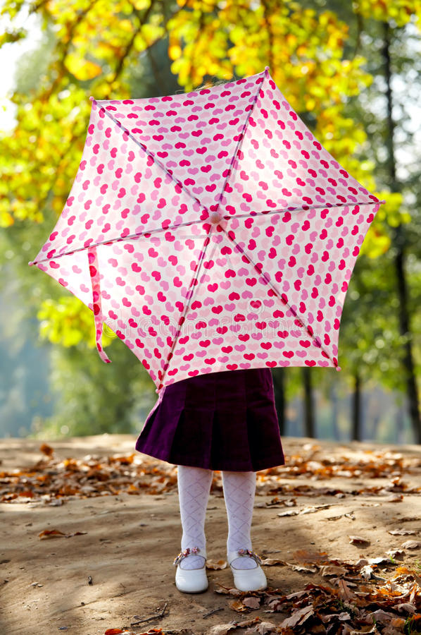 Free Little Girl Hiding Behind Umbrella Royalty Free Stock Image - 17158836