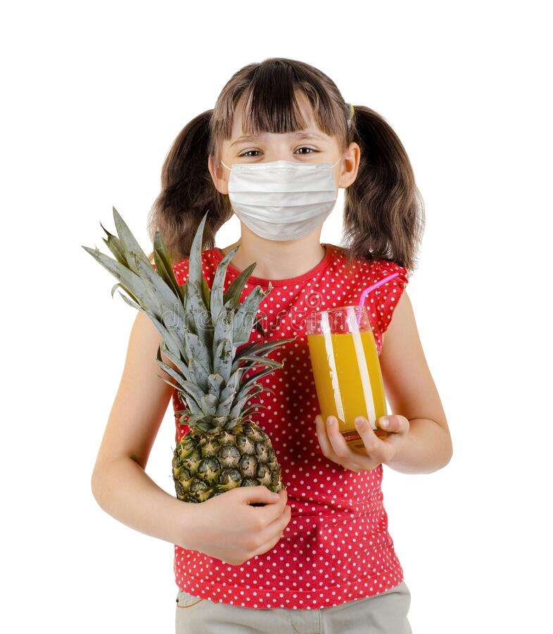 Little girl hold pineapple and juice royalty free stock photos