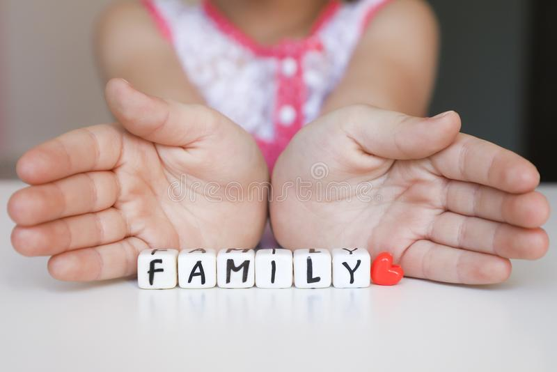Little girl hold toy blocks. Protect your family concept. royalty free stock image