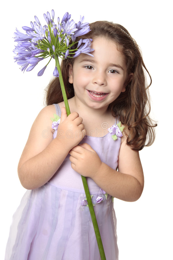 Little girl holding african lily royalty free stock image