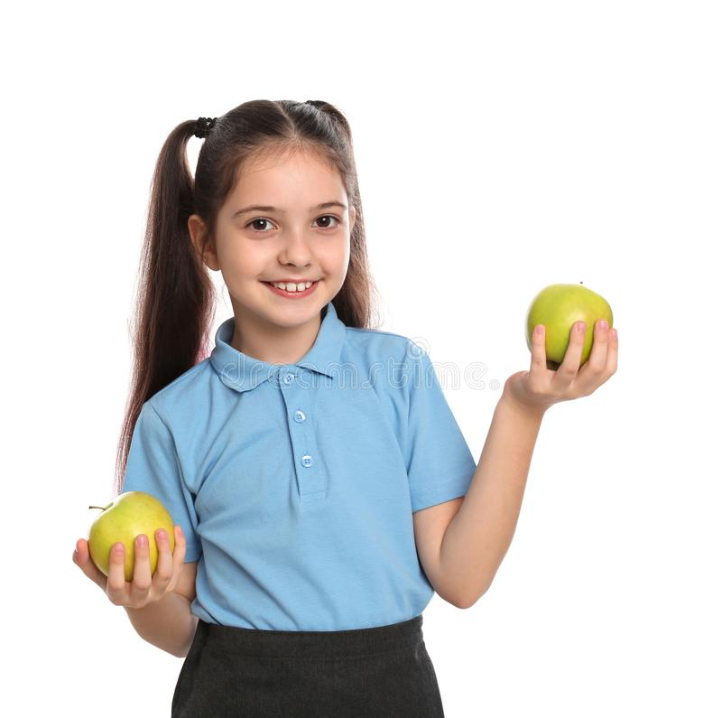 Little girl holding apples on white. Healthy food for school lunch royalty free stock photo