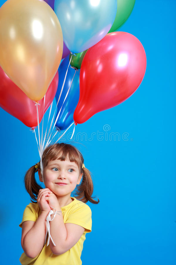 Free Little Girl Holding Balloons Stock Photography - 9406662
