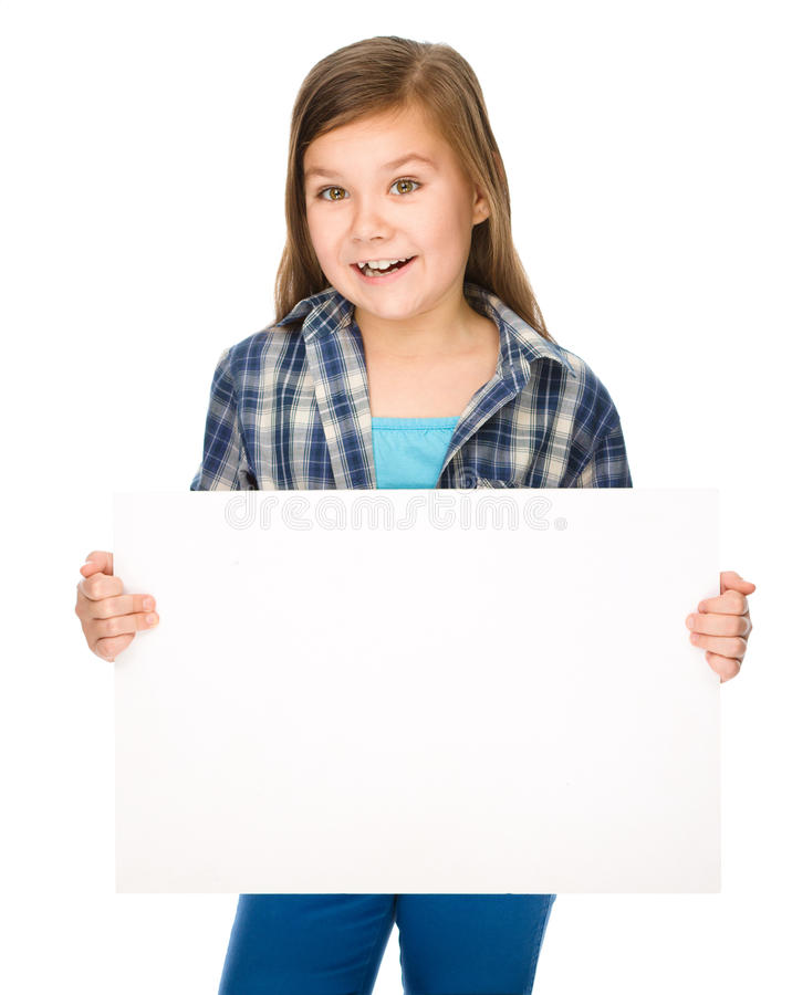 Little girl is holding a blank banner. Isolated over white royalty free stock image