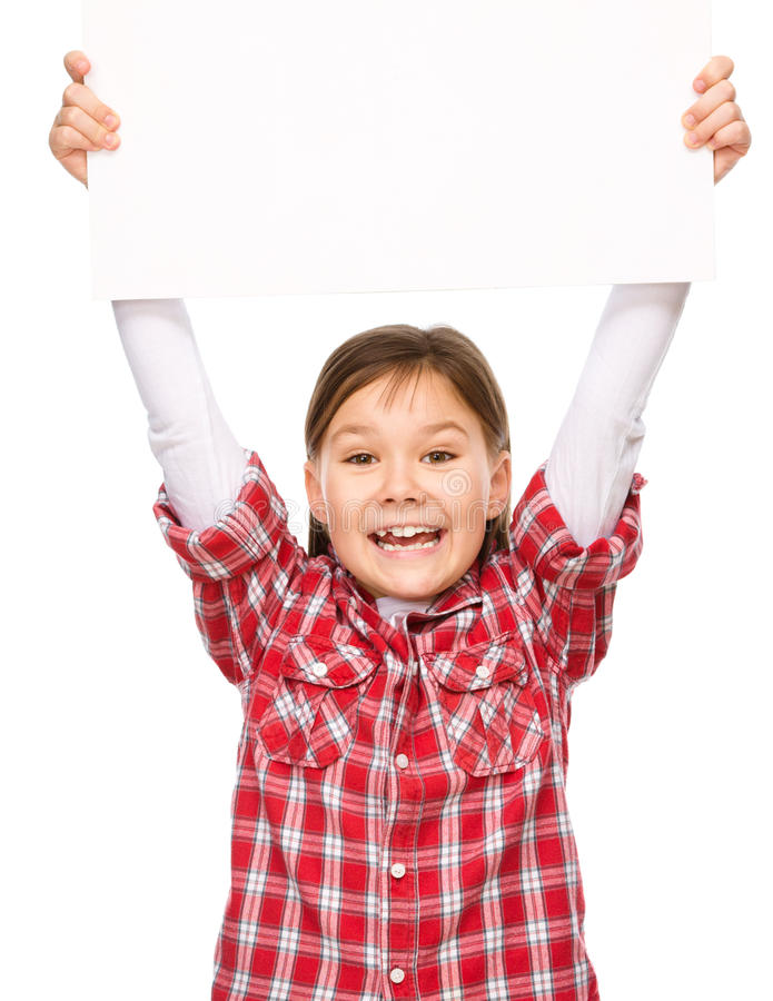 Little girl is holding a blank banner. Isolated over white royalty free stock images