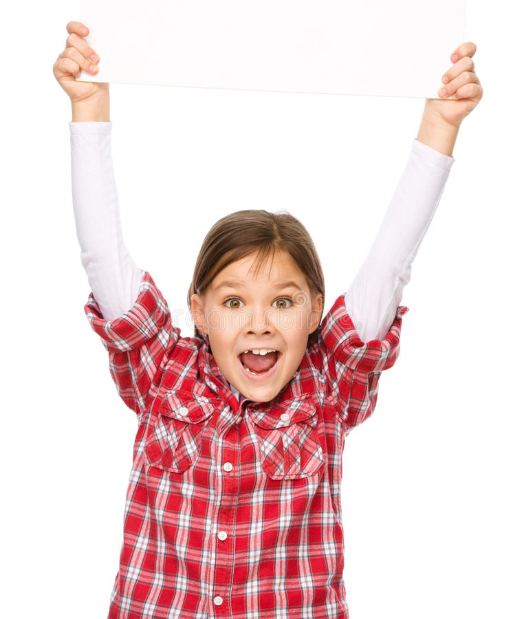 Little girl is holding a blank banner. Isolated over white stock photography