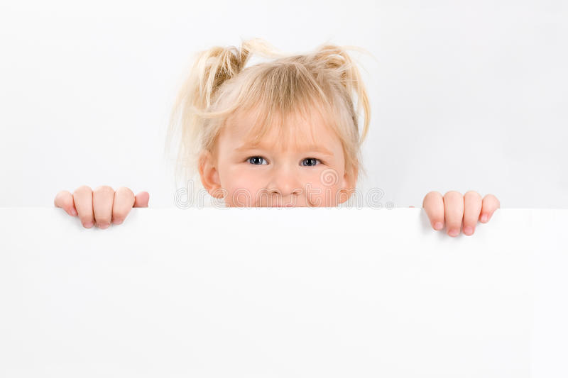 Little girl holding blank sign royalty free stock photography