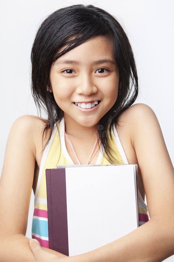 Little girl holding book stock photos