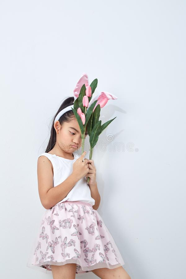 little girl holding bouquet tulip stock photography