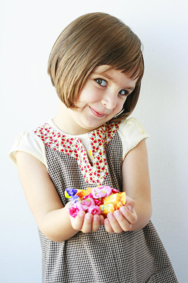 Free Little Girl Holding Candies Stock Photography - 20853492