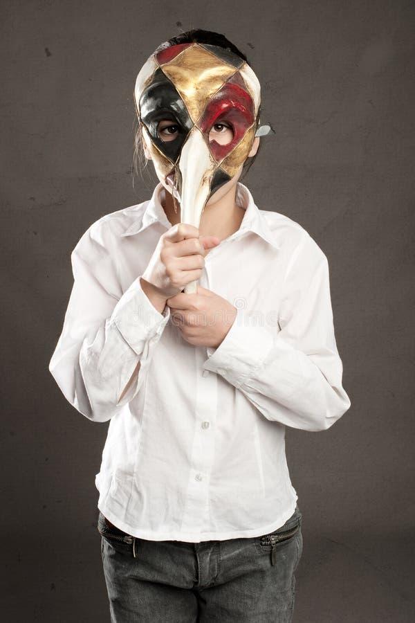 Little girl holding carnival mask stock image
