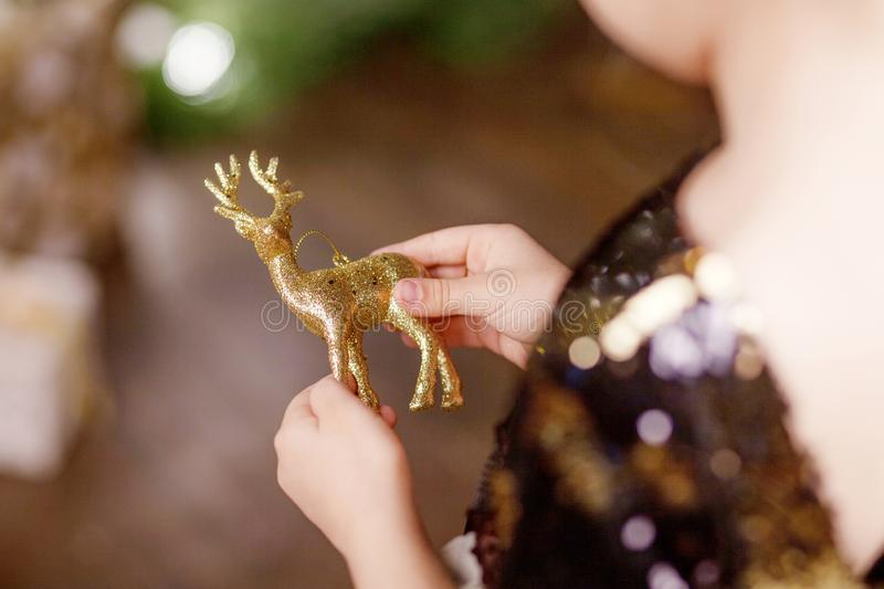 Little girl holding a fir-tree toy. Christmas and new year concept.  Christmas decor. Child`s hands holding beautiful christmas stock images