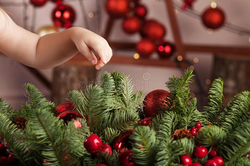 Little girl holding a fir-tree toy. Christmas and new year concept.  Christmas decor. Child`s hands holding beautiful christmas to. Y stock images