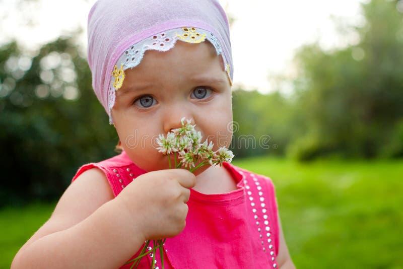 Little Girl Holding Flower Outdoors High-Res Stock Photo