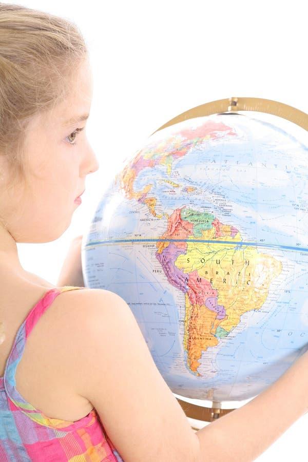 Little girl holding globe royalty free stock photos