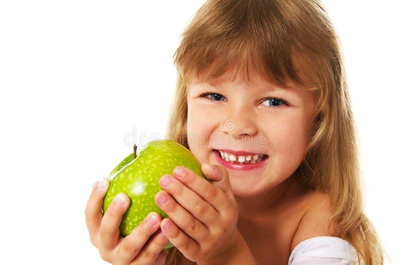 Little girl holding green apple stock photography