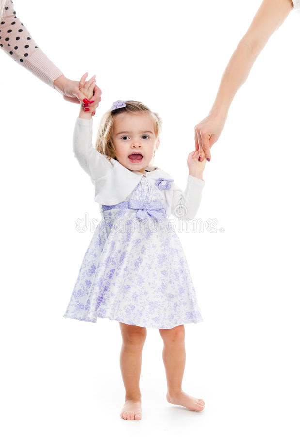 Little girl holding the hand royalty free stock photo