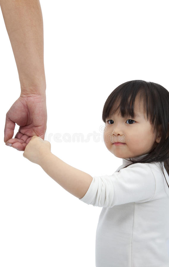 Little girl holding the hand of the father royalty free stock photography
