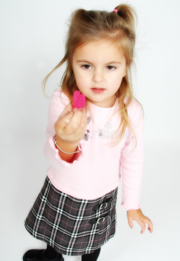 Little girl holding a heart royalty free stock photography