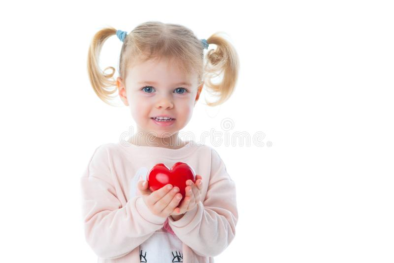 Little girl with flowers and a gift stock image