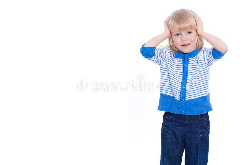 Little girl holding her hands on head. Over white stock photo