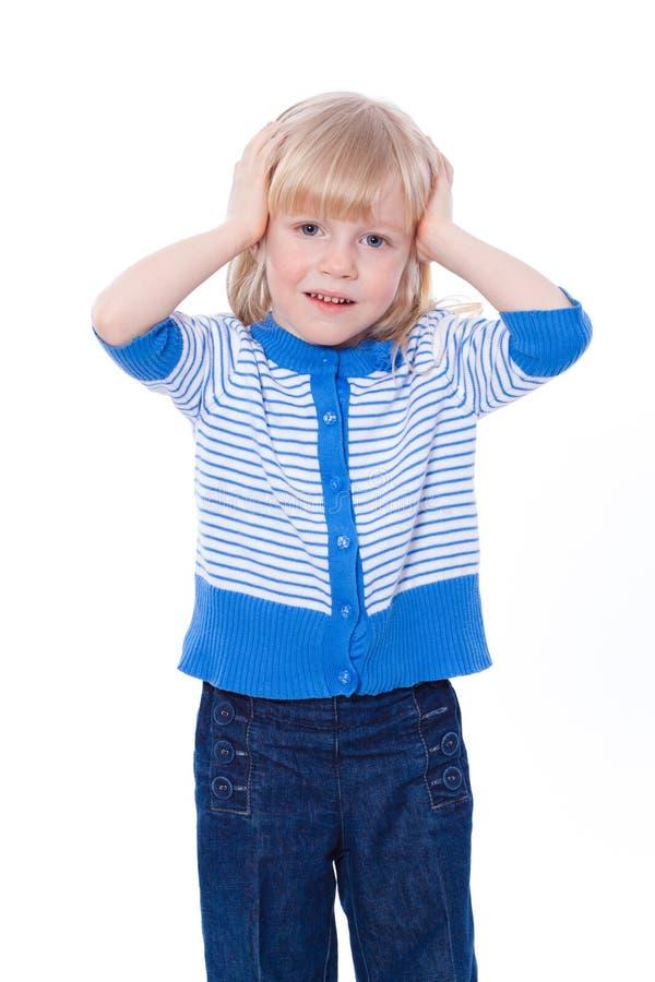 Little girl holding her hands on head. Over white stock images