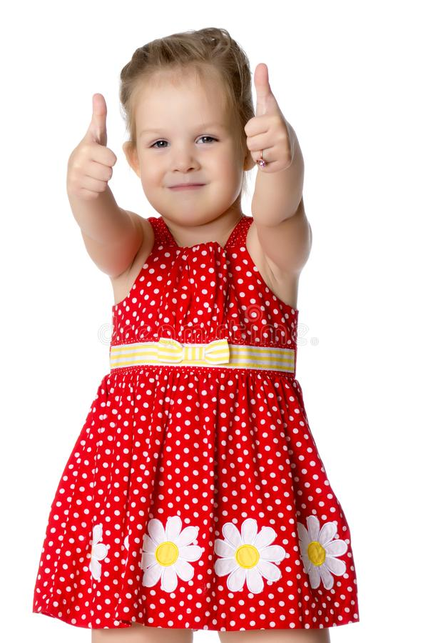 Little girl holding her thumb up royalty free stock photography