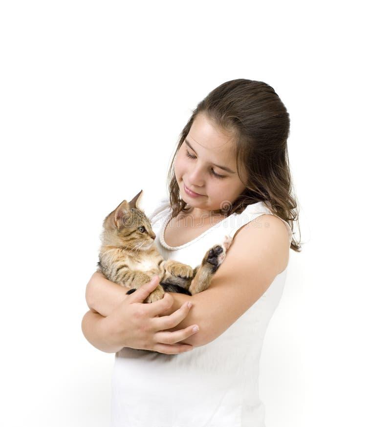Little girl holding a kitten stock images