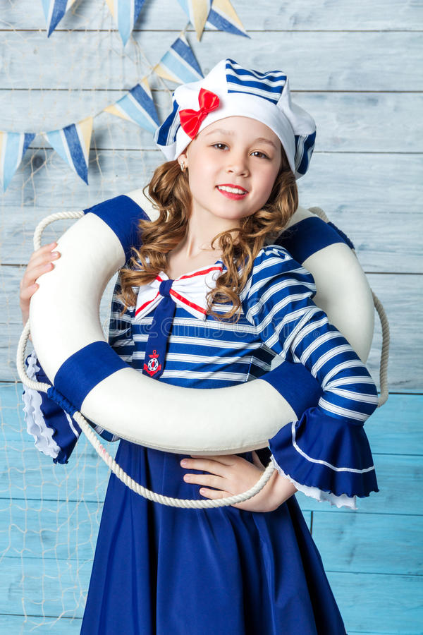 Little girl holding a lifebuoy and laughing stock photos