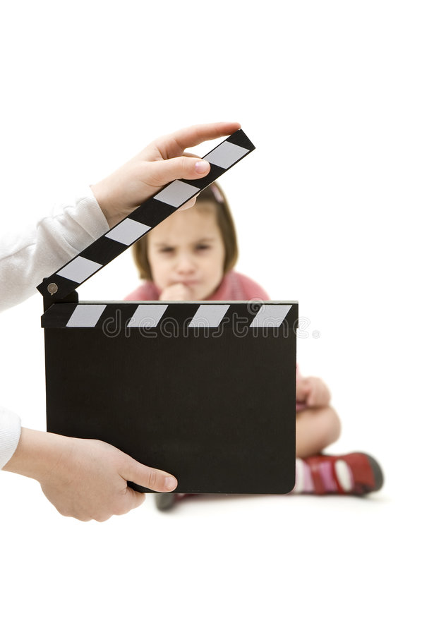 Little girl holding a movie clapper stock images