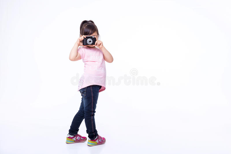 Little girl holding an old camera royalty free stock images