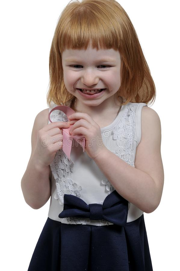 Little girl with breast cancer ribbon stock photography