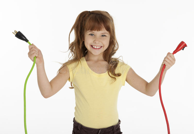 Little Girl Holding Power Cords royalty free stock photography