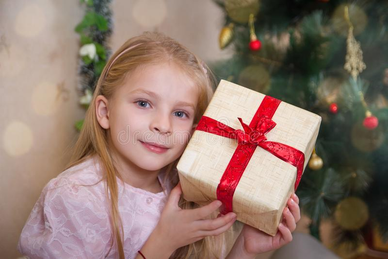 Little girl holding present box at Christmas royalty free stock image