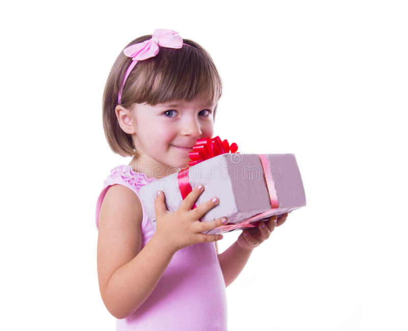 Little girl holding present box royalty free stock photography