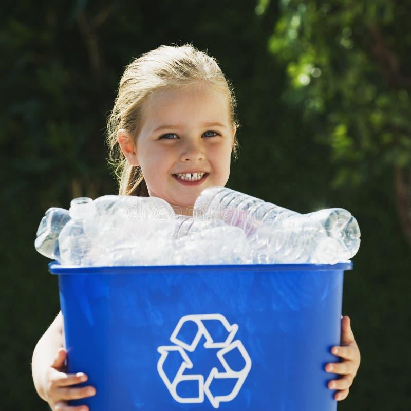 Little Girl Holding Recycling Bin. Little blond Girl Holding Recycling Bin royalty free stock image