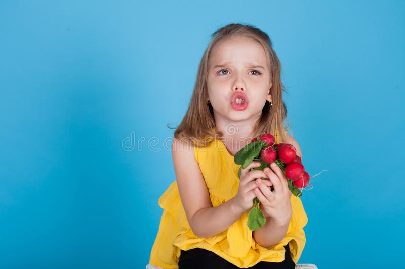 Little girl holding a red radishes healthy food vegetables royalty free stock photos