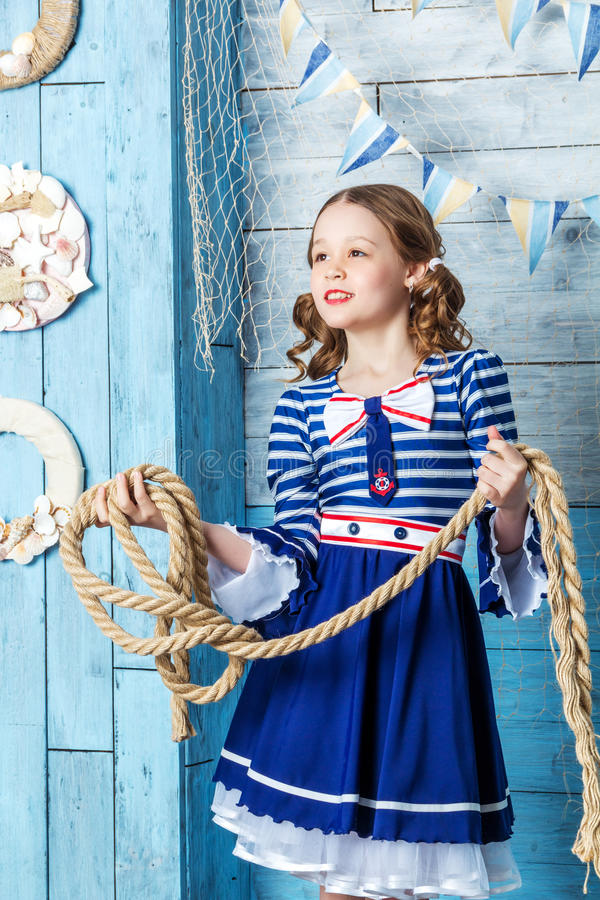 Little girl holding a rope stock photos
